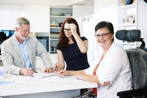Margie consults over the design of her home modification