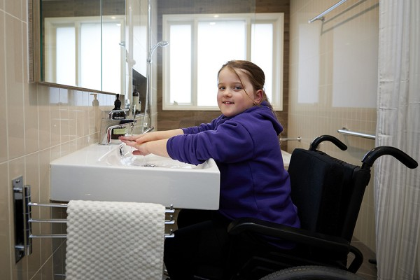 Hayley in her new accessible bathroom designed by Home Modification Victoria.