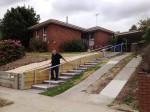 Steven walks down accessible steps.